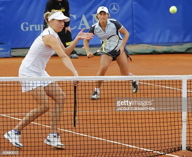 Italian pair Mara Santangelo and Tatiana Garbin play against their Russian opponents Dinara SafinaVera Douchevina 24 April 2005 during their...
