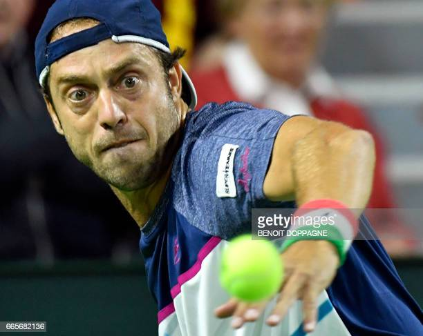 Italian Paolo Lorenzi competes against Belgian Steve Darcis during the Davis Cup World Group quarterfinal between Belgium and Italy on April 7 in...