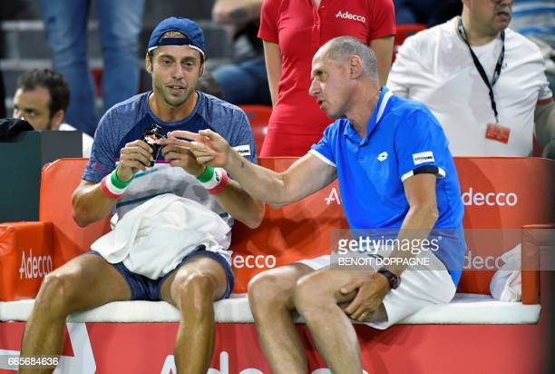 Italian Paolo Lorenzi listens to Italian captain Corrado Barazzutti during the Davis Cup World Group quarterfinal between Belgium and Italy on April...