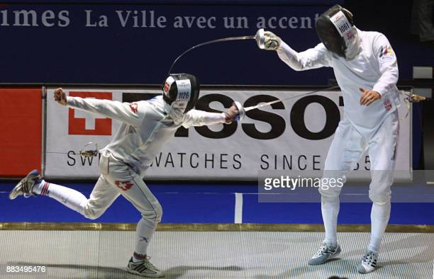 Italian Paolo Milanoli touches Swiss Basil Hoffman in the mens sabre final in which Milanoli won gold at the World Fencing Championships 29 October...