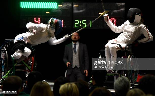 TOPSHOT Italian Paralympic Champion Beatrice Bebe Vio competes against US athlete Ellen Geddes during the Wheelchair Fencing World Championship in...