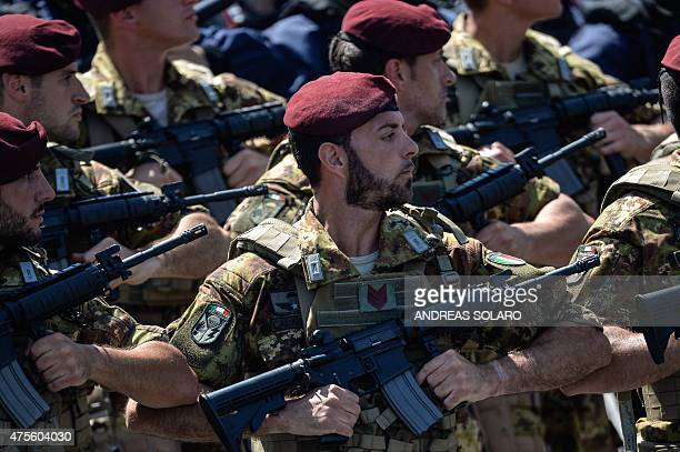 Italian paratroopers march on Via dei Fori Imperiali in central Rome on June 2 during the military parade as part of celebrations marking Italy's...