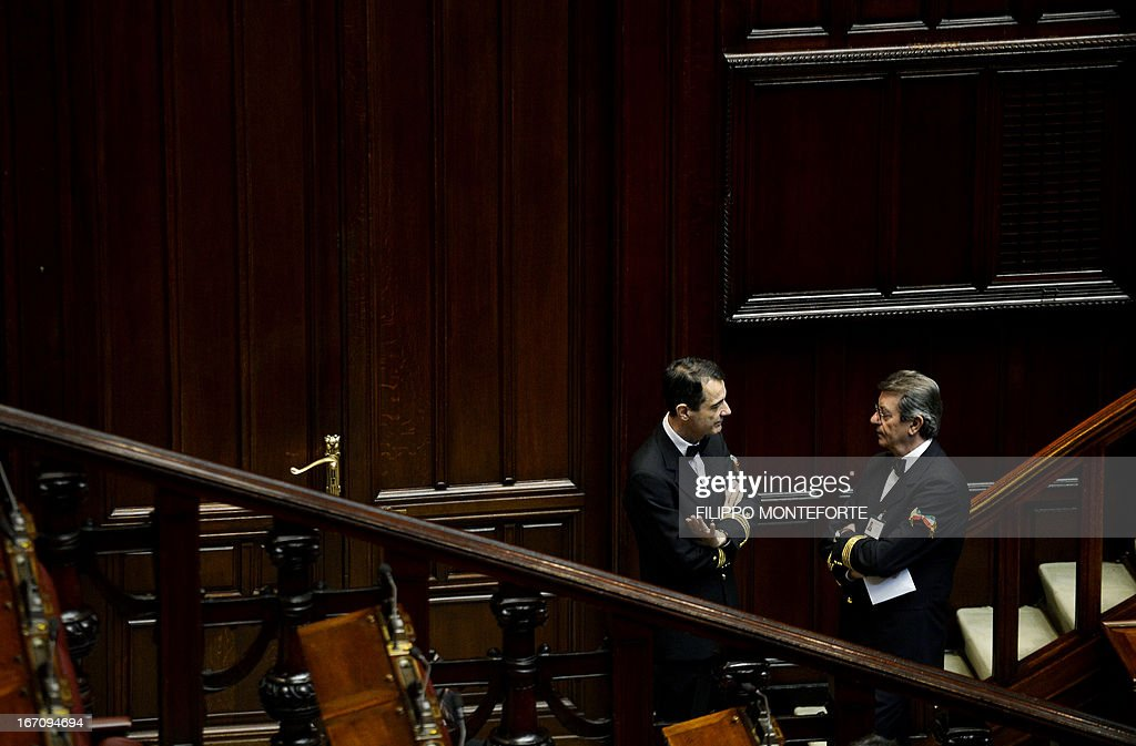Italian Parliament ushers stand during the election of Italy's President on April 20, 2013 at the Italian parliament in Rome. Voting in Italy's parliament to pick a president entered a chaotic third day today, with the left in total disarray after its leaders resigned over failure to get their candidates elected. The situation deepened a political crisis triggered by a general election two months ago that left no clear winner to govern the country. Ex-trade union leader Franco Marini and widely respected former European Commission chief Romano Prodi have both now withdrawn their candidacies to be president, and the top-selling Corriere della Sera daily said the country was 'suspended in a void'.
