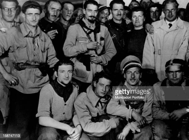 Italian partisan and lawyer Pier Luigi Bellini delle Stelle posing with some partisans after they arrested Benito Mussolini and fascist gerarchi on...