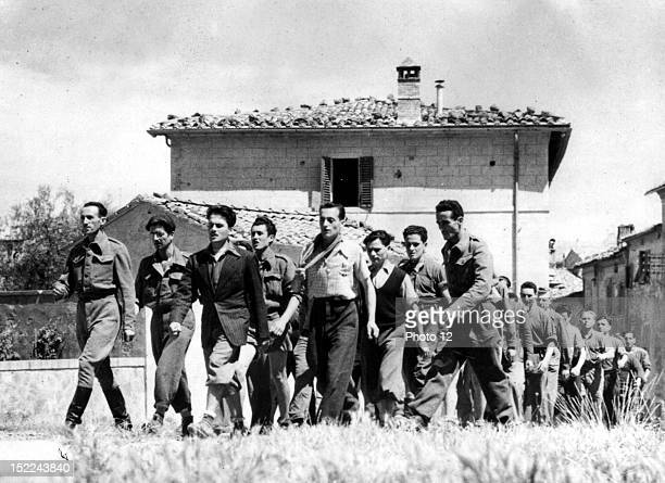 Italian partisans some of those who helped fight the Germans and capture the local fascists march outside the town of Montalcino summer 1944