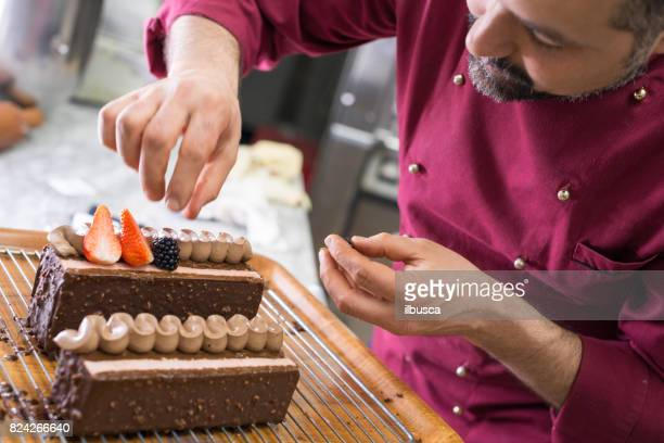 Italian pastry making patisserie baking confectioner: Decorating cake with fruits