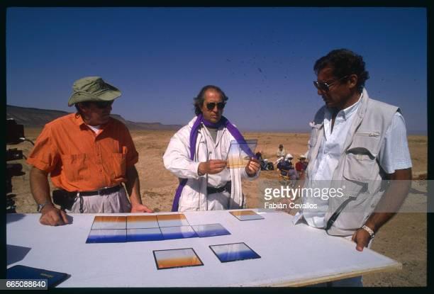 Italian photography director Vittorio Storaro stands between camera operators Michele Picciaredda and Enrico Umetelli on the set of the movie Un The...