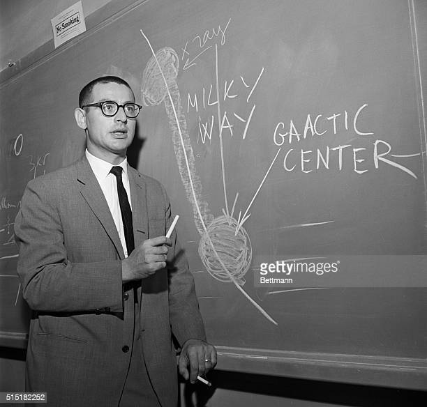 Italian physicist Riccardo Giacconi explains a diagram of two previously unknown sources of space radiation at an Xray symposium at Stanford...