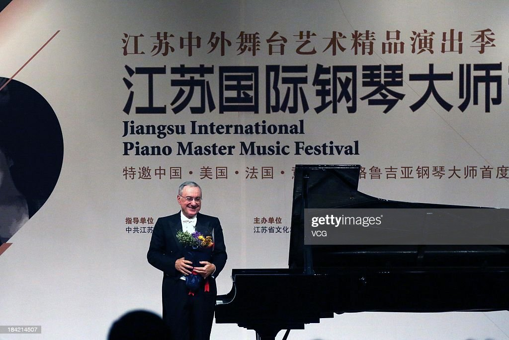 Italian pianist Michele Campanella performs on the stage during the Jiangsu International Piano Master Music Festival at Nanjing University of the Arts on October 11, 2013 in Nanjing, China.