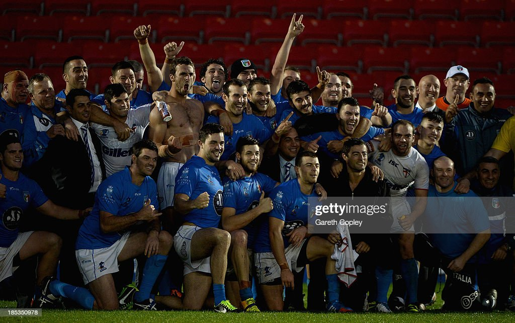 Italian players celebrate after winning the International match between England and Italy at Salford City Stadium on October 19, 2013 in Salford, England.