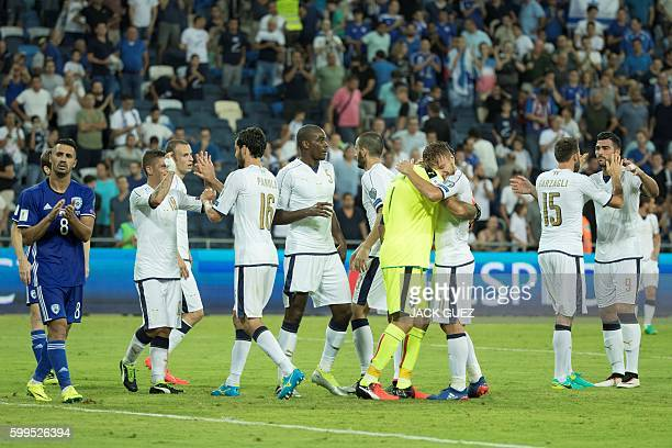 Italian players celebrate their victory at the end of the World Cup 2018 qualifier football match Israel vs Italy at Sammy Ofer Stadium in Haifa on...