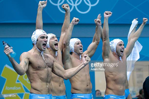 Italian players celebrate winning the Men's Water Polo Semifinal match between Italy and Serbia on Day 14 of the London 2012 Olympic Games at the...