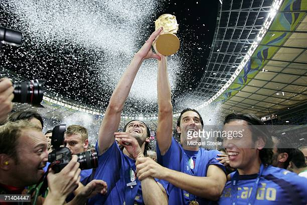 Italian players celebrate with the world cup trophy after their team's victory during the FIFA World Cup Germany 2006 Final match between Italy and...