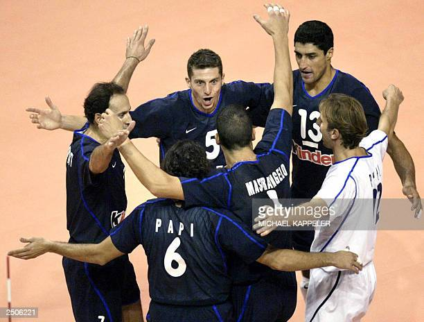 Italian players jubilate after they won 30 against Russia in their Euro 2003 volleyball semifinal match 13 September 2003 in Berlin From left...