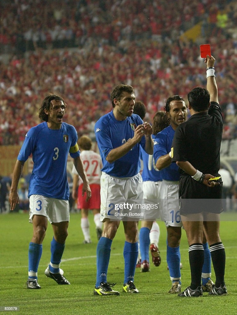 Italian players react to referee Byron Moreno of Ecuador decision to send off <a gi-track='captionPersonalityLinkClicked' href=/galleries/search?phrase=Francesco+Totti&family=editorial&specificpeople=208985 ng-click='$event.stopPropagation()'>Francesco Totti</a> of Italy during the FIFA World Cup Finals 2002 Second Round match between South Korea and Italy played at the Daejeon World Cup Stadium in Daejeon, South Korea on June 18, 2002. South Korea won the match 2-1 with a Golden Goal in extra-time.