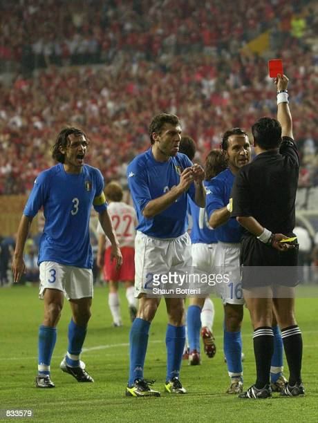 Italian players react to referee Byron Moreno of Ecuador decision to send off Francesco Totti of Italy during the FIFA World Cup Finals 2002 Second...