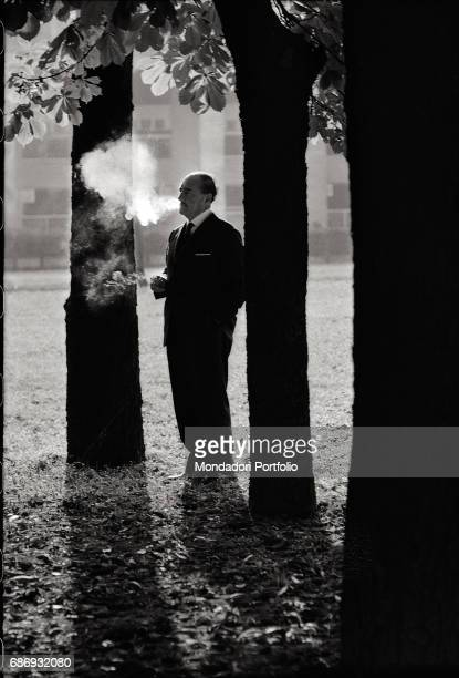 Italian poet Salvatore Quasimodo smoking in a park This picture is taken from the monography 'Mario De Biasi Il mio sogno Š qui' curated by Enrica...