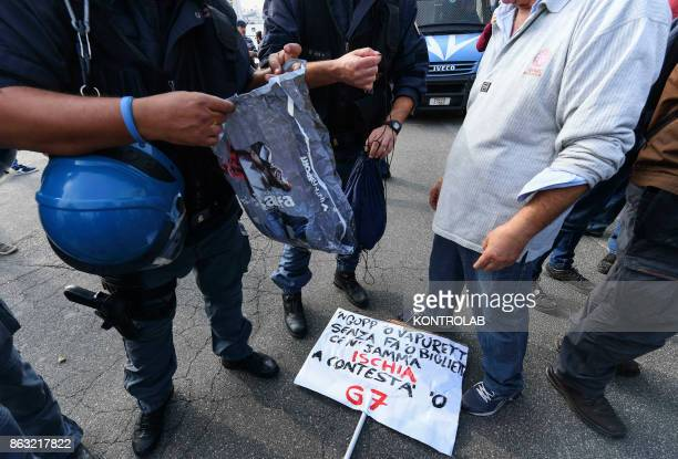 Italian Police checks demonstrators who take part in a protest against the G7 Meeting of Interior Ministers takes place in Ischia