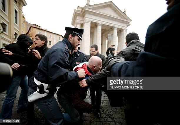 Italian police detain a man after he threatened to set himself alight in Saint Peter's Square at the Vatican on February 11 to protest against...