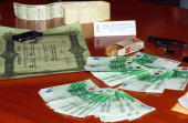 Italian police display some counterfeit euro bills on a table at the end of a news conference at police headquarters in Reggio Calabria southern...