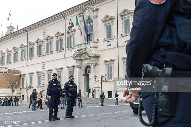 Italian police form security cordons in front of the Quirinale Palace prior the arrival of Queen Elizabeth II on April 3 2014 in Rome Italy During...