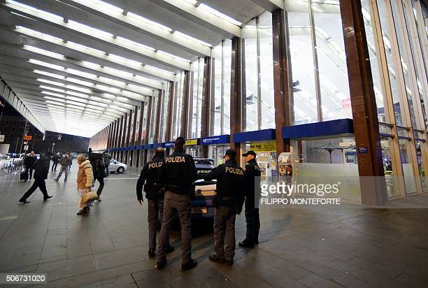 Italian police officers stand guard outside Rome's Termini station that was evacuated after railway police said they had received an alert that an...