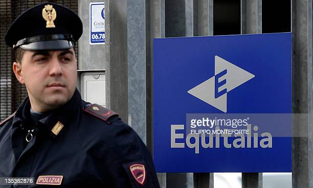 Italian police officers stand outside the Equitalia buildinga public company responsible for collecting taxes in Italy after a letterbomb exploded in...