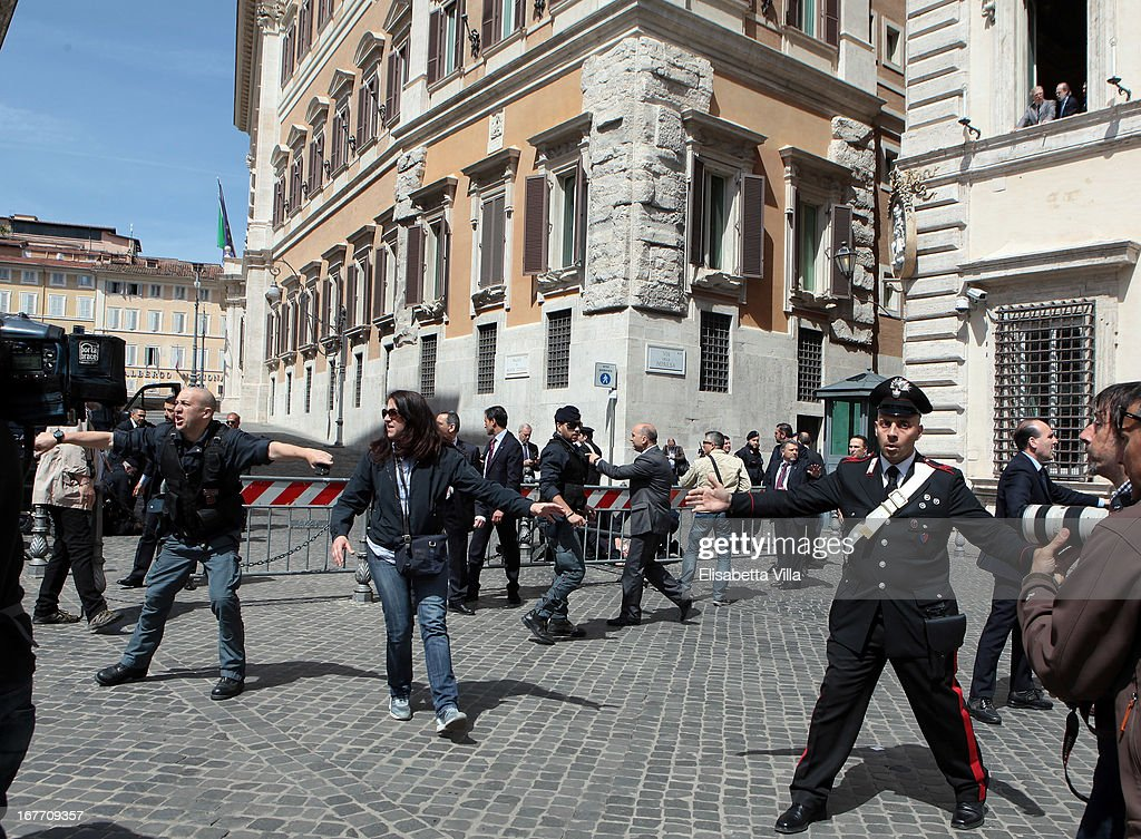 Italian police stand as they patrol around the area where gunshots were fired, in front of the Chigi Premier's office on April 28, 2013 in Rome, Italy. Two military police officers were shot in the square outside Palazzo Chigi while the new government of Enrico Letta was being sworn in. The attacker was caught and the authorities identified him as Luigi Preiti a unemployed man born in 1964 in Calabria.