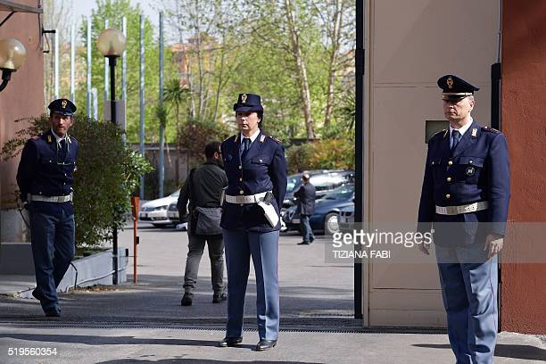 Italian police stand guard outside the main gate of a police station in Rome on April 7 2016 as they wait for the arrival of Egyptian investigators...