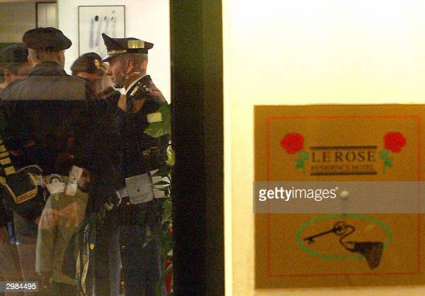 Italian police stand in the entrance of 'The Rose' hotel in Rimini early 15 February 2004 where the body of former Italian champion cyclist Marco...