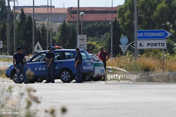 Italian policemen control the access to the main gate of the port of Gioia Tauro on July 1st 2014 where Danish ship Ark Future would arrive from...