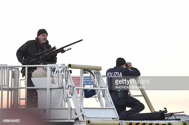 Italian policemen snipers stand guard as Pope Francis boards a plane to Africa on November 25 2015 at Fiumicino Rome's international airport Pope...