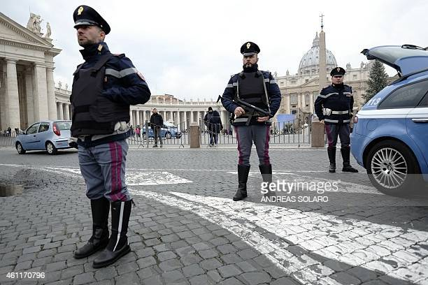 Italian policemen stand guard near the Vatican on January 8 2015 in Rome Italy called a meeting of its 'antiterrorism' committee yesterday to examine...