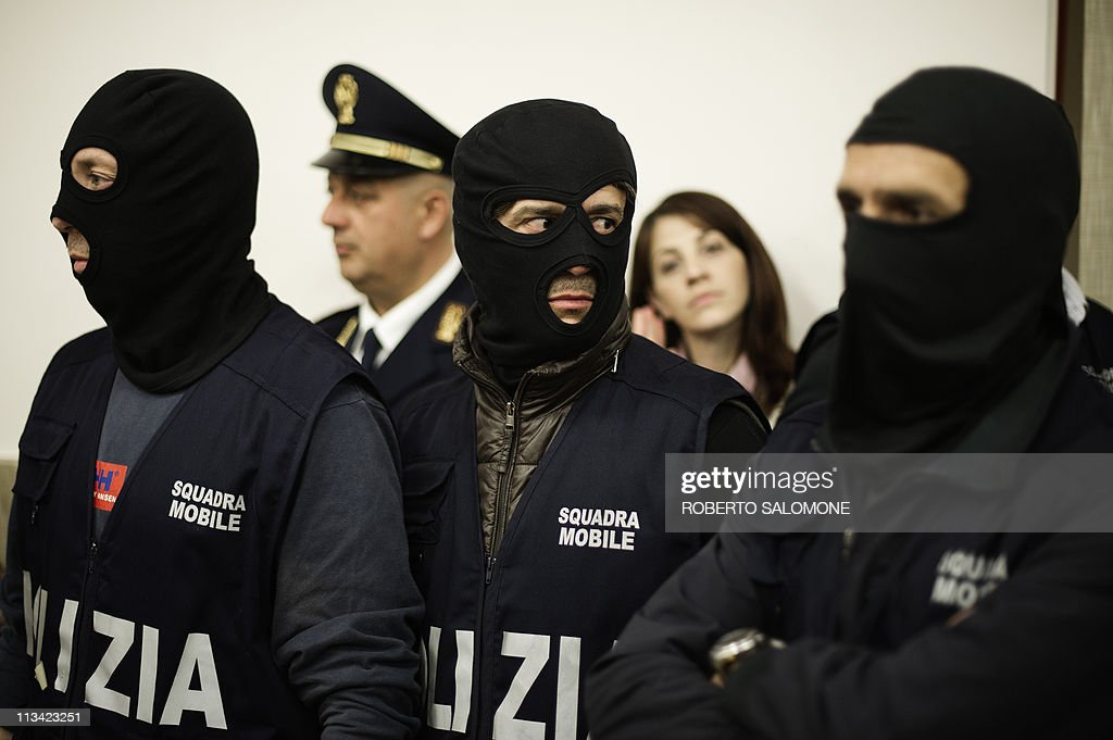 Italian policemen who caught Italian fugitive Marco Caterino of the Casalesi mafia organisation attend a press conference after the mob leader's...