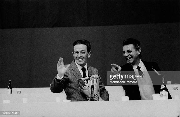 Italian politician and General Secretary of the Italian Communist Party Enrico Berlinguer and Italian politician Antonio Tatò smiling during the 16th...