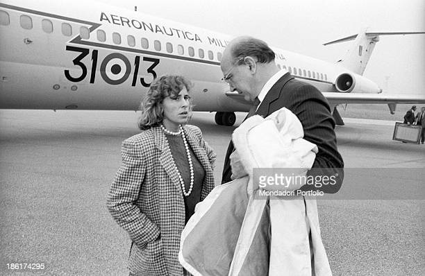 Italian politician and President of the Council of Ministers of the Italian Republic Bettino Craxi talking to his daughter Italian deputy Stefania...