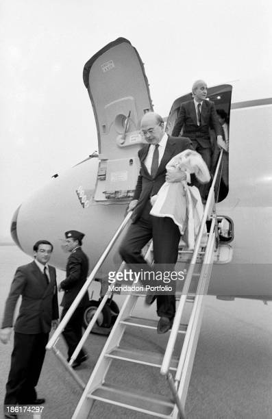 Italian politician and President of the Council of Ministers of the Italian Republic Bettino Craxi getting off the Italian Air Force airplane that...