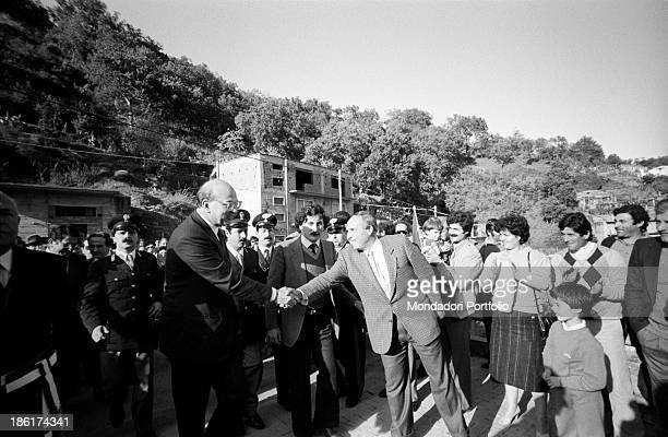 Italian politician and President of the Council of Ministers of the Italian Republic Bettino Craxi shaking the hand of a man The politician is in...
