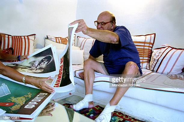 Italian politician Bettino Craxi holding a poster in his villa in Hammamet where he went into hiding Hammamet 1995