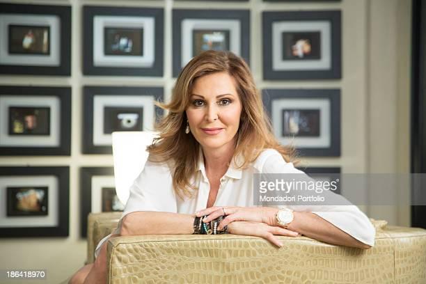 Italian politician Daniela Santanchè sitting on a sofa at home Milan 27th April 2012