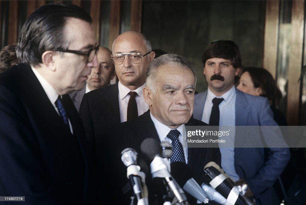 Italian politician Giulio Andreotti listening Israeli politician Yitzhak Shamir speaking into the microphone. 1980s.