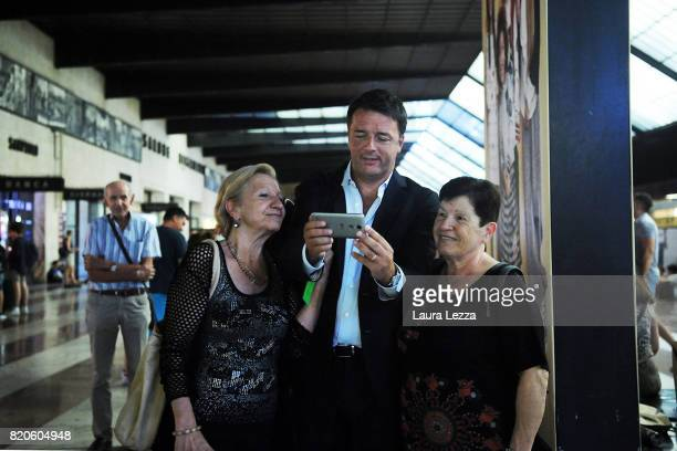 Italian politician Matteo Renzi Secretary of the Democratic Party takes a selfie with people while arriving at Santa Maria Novella train station...