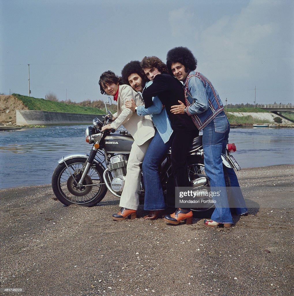 Italian pop band Cugini di Campagna posing holding a ...