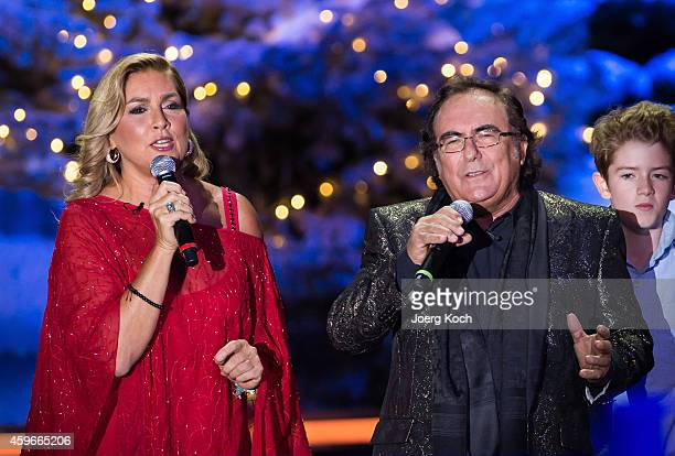 Italian pop duo Al Bano and Romina Power perform at the taping of the TV show 'Heiligabend mit Carmen Nebel' on November 27 2014 in Munich Germany