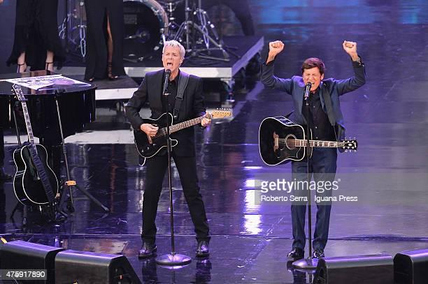 Italian pop singer Claudio Baglioni and Gianni Morandi performs at the 2015 Wind Music Awards at Arena di Verona on June 4 2015 in Verona Italy