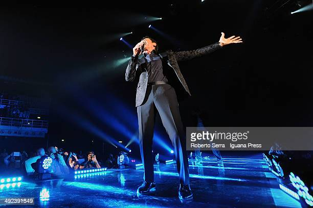 Italian popsinger Gianni Morandi performs at Unipol Arena on May 10 2014 in Bologna Italy