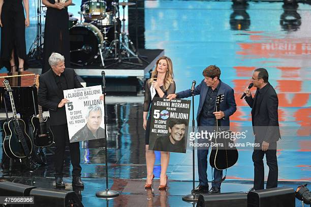 Italian popsingers and authors Claudio Baglioni and Gianni Morandii attends the show of Wind Music Awards with the presenters Vanessa Incontrada and...