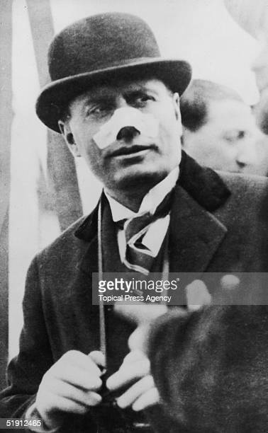 Italian Premier Benito Mussolini leaving for Tripoli 13th May 1926 His nose is bandaged after an assassination attempt on 26th April by Violet Gibson...