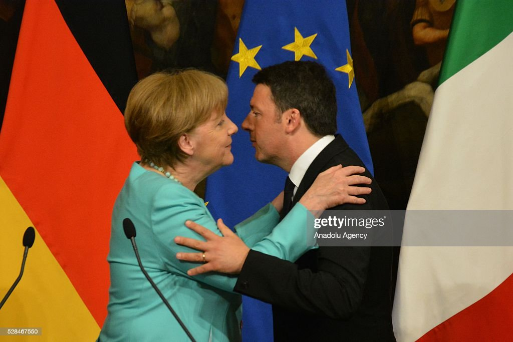 Italian Premier Matteo Renzi (R) and German Chancellor Angela Merkel embrace each other during a press conference after a bilateral meeting, in Rome, Italy, 05 May 2016.