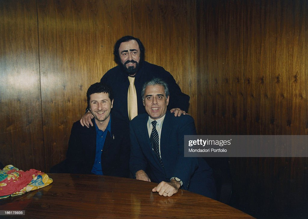 Italian presenter Fabio Fazio Italian comedian and actor Teo Teocoli and Italian tenor Luciano Pavarotti are the presenters of the 50th Sanremo Music...